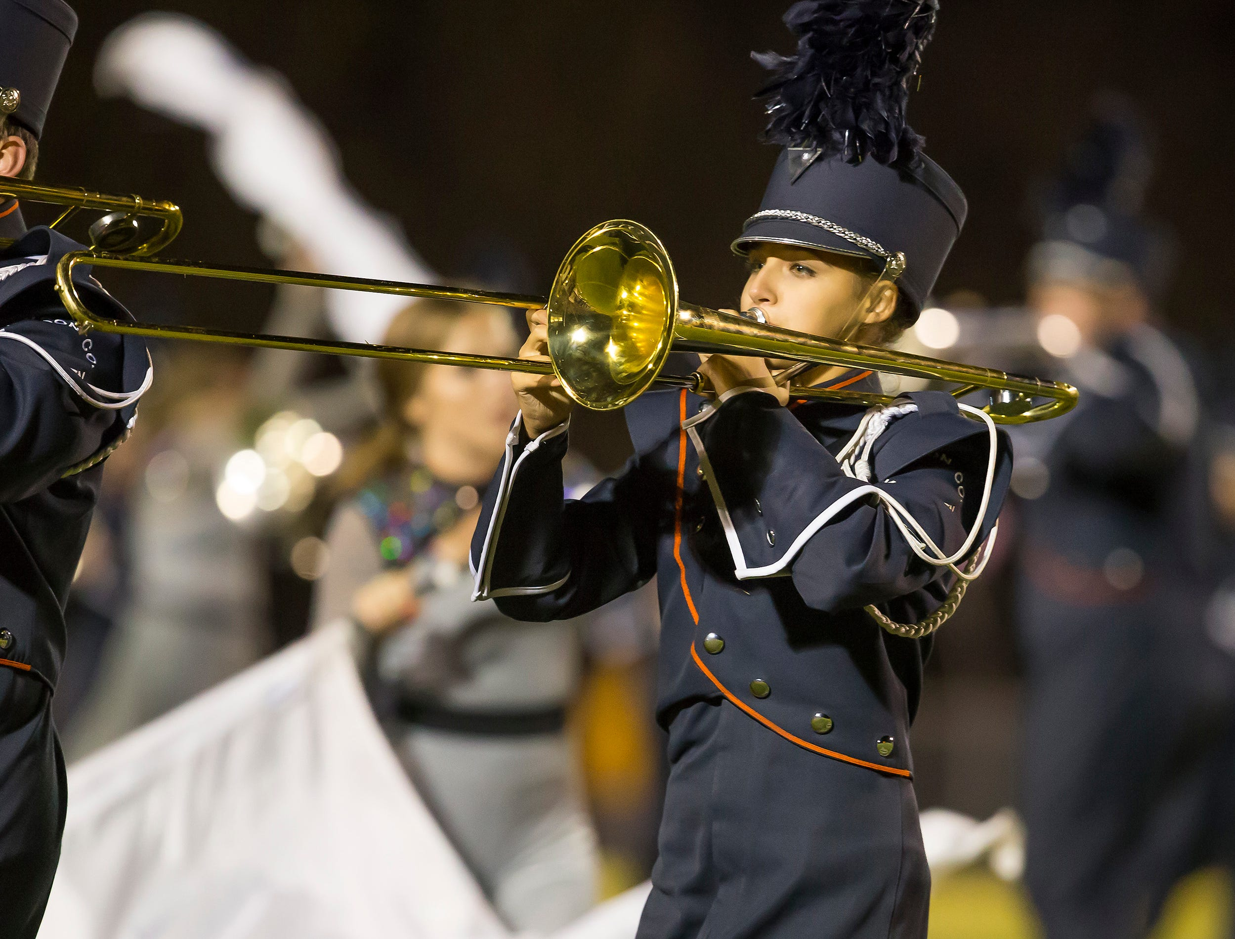 Dickson County's Band  and Color Guard performs at half time of the Dickson County vs Lawrence County game.