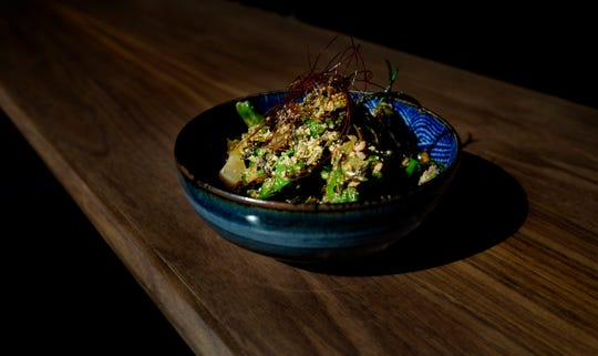 A dish of dandan shishitos, with Chinese preserved vegetables, peanuts and spicy pork, is available at The Green Pheasant, a new Japanese restaurant in SoBro. The Green Pheasant features seasonal dishes made with fresh fish and other ingredients from Japan and Tennessee farmers.
