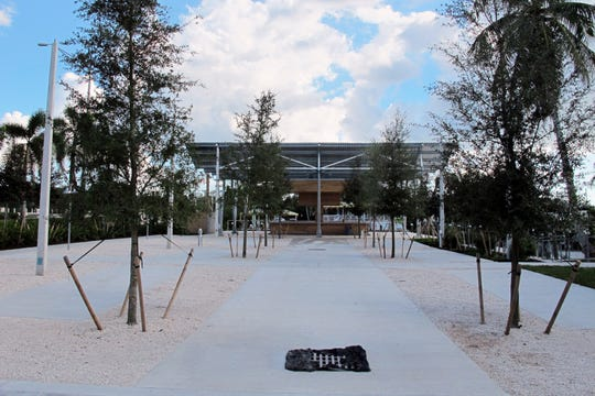 Food trucks eventually will line both sides of this walkway leading to the bar at Celebration Park off Bayshore Drive in East Naples.