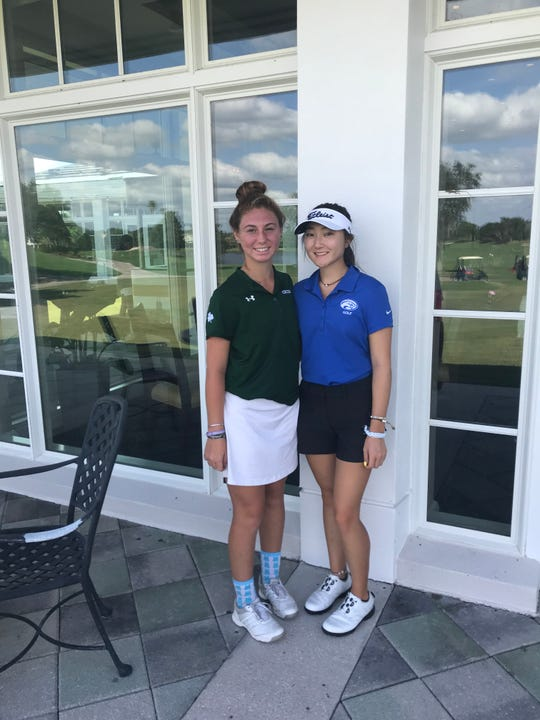 Individual qualifiers Sophie Shrader of St. John Neumann and Brittany Shin of Canterbury pose together after qualifying for state.