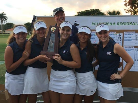 The Estero High School girls golf team poses with the trophy after winning the Class 2A-Region 7 title at Herons Glen in Fort Myers on Monday, Oct. 22, 2018