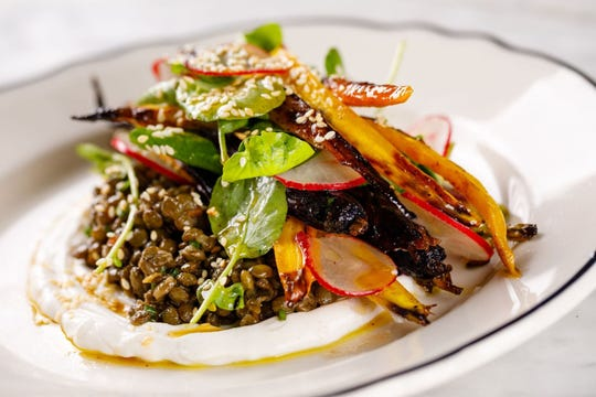 A roasted carrot salad with lentils du puy, watercress, radish, red wine vinaigrette and lime yogurt is on the new seasonal menu at The French in downtown Naples.