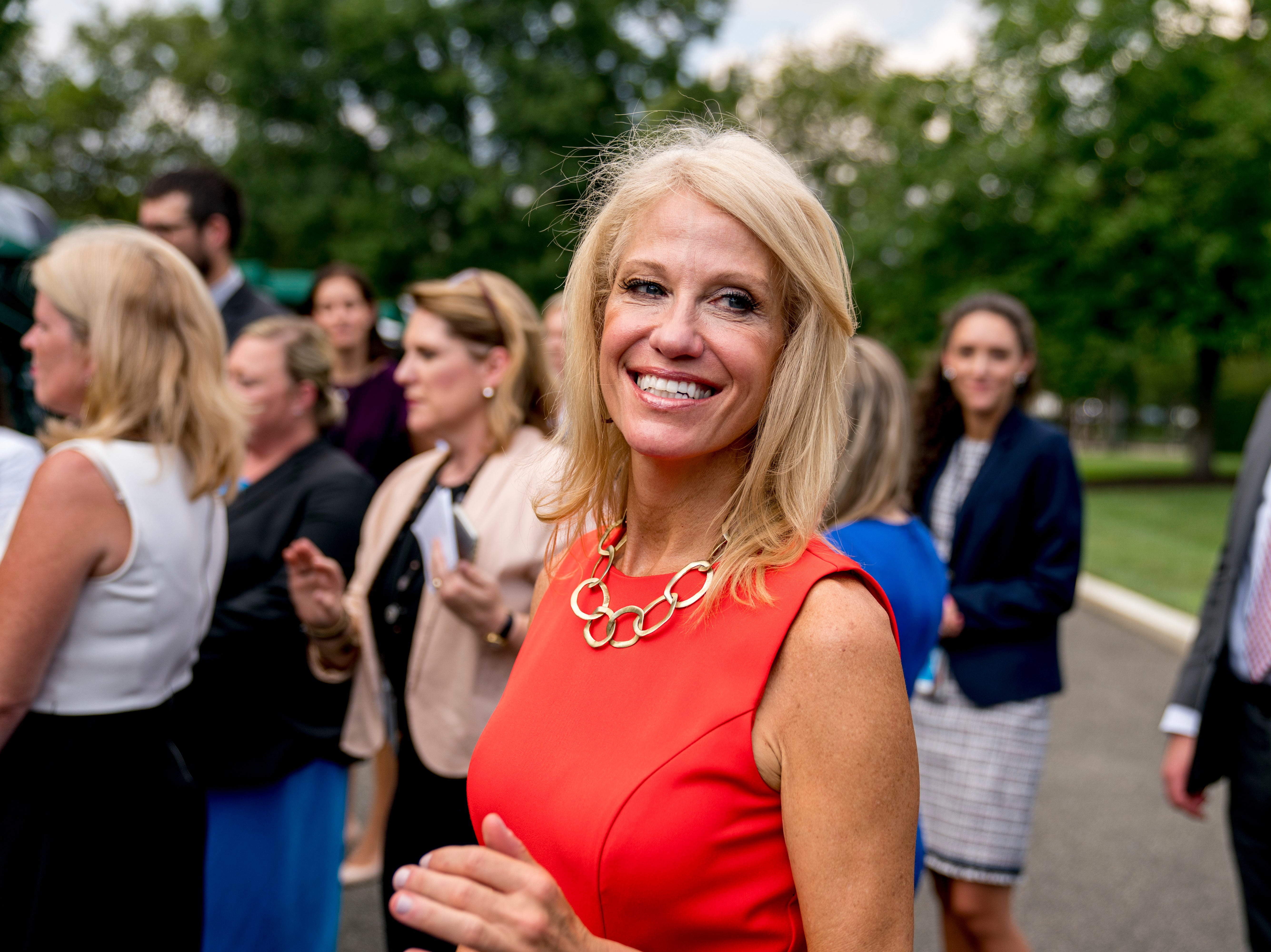 Counselor to the President Kellyanne Conway stands outside the West Wing of the White House, Wednesday, Aug. 29, 2018, in Washington. (AP Photo/Andrew Harnik)