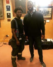 Auxiliary Fort Lee firefighter Khaleel Thomas, who is also a new recruit starting fire school next month, posed with former New York Giant Justin Tuck when he visited the department.