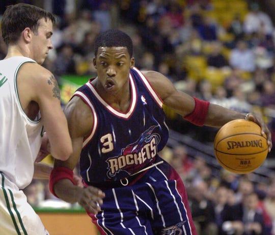Houston Rockets' Steve Francis (3) drives past Boston Celtics' Chris Herren in the first quarter Wednesday, Nov. 22, 2000, in Boston. (AP Photo/Michael Dwyer)