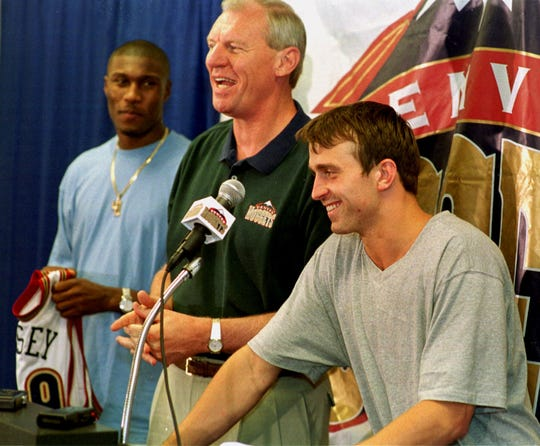 Denver Nuggets general manager Dan Issel, center, jokes with his  team's top draft picks, Xavier of Ohio's James Posey, left, and Fresno State guard Chris Herren, right, as Issel introduces the pair to reporters during a news conference on Thursday, July 1, 1999, in Denver's McNichols Sports Arena. Posey was the team's top pick and the 18th selection overall in the draft while Herren was the 33rd selection in the draft. (AP Photo/David Zalubowski)