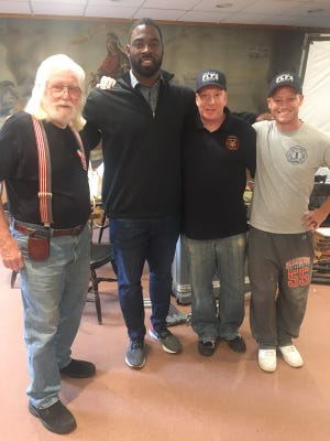 Ex-Fort Lee Fire Chief Terry Holtje,  Former New York Giant Justin Tuck, Deputy Chief Christopher Ipek and Lt. Shawn Werner.