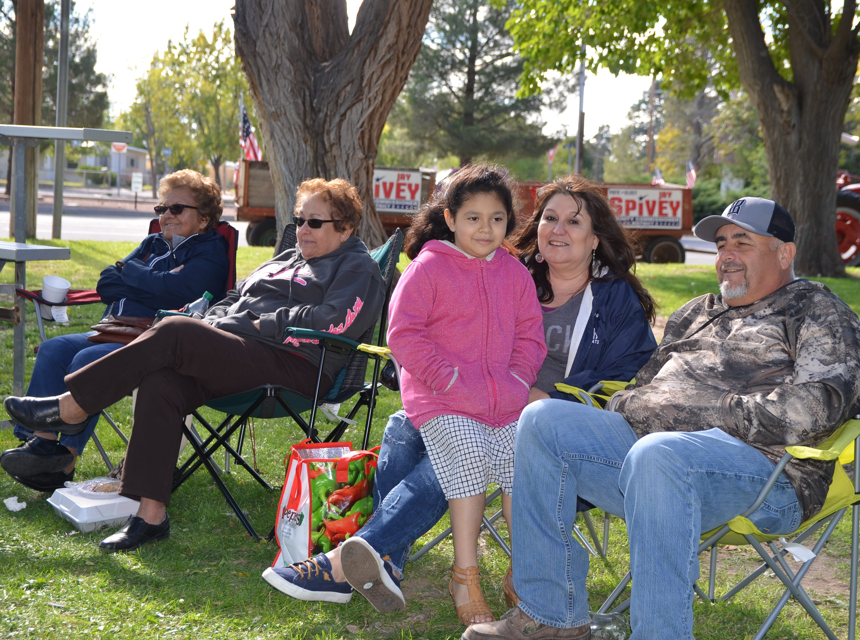 Second from Left: Patsy Leyba accompanied her family and friend to enjoy the music from the band, Alegria during the Klobase Festival on Sunday.