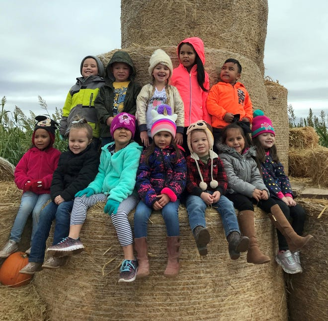 Students of Fruit of the Vine Preschool enjoyed a field trip to the KMI Pumpkin Patch last week. They enjoyed walking through the octopus-shaped corn maze, picking out and harvesting their own pumpkins and they topped their day off with fun fall games and climbing the hay stack mountain. FOTV is located at the Holy Family Catholic Church Parish Center, under the direction of Maggie Armijo at 615 S. Copper St.