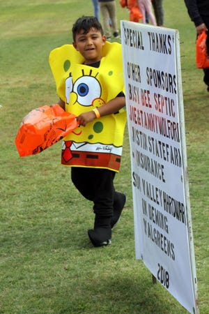 Leo Balencia, 6, paraded throughout the park in his SpongeBob SquarePants costume in 2018.