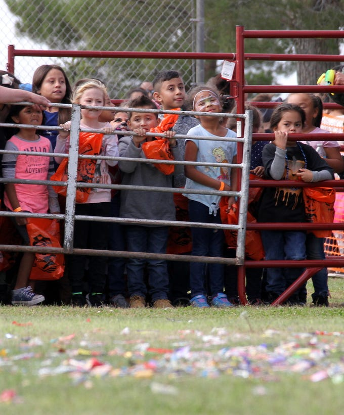 Children wait for the candy to drop from 100 feet high.