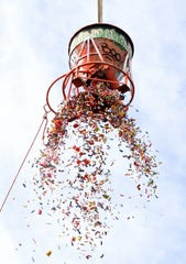 The Halloween-decorated construction bucket dropped candy suspended 100 feet above the park.