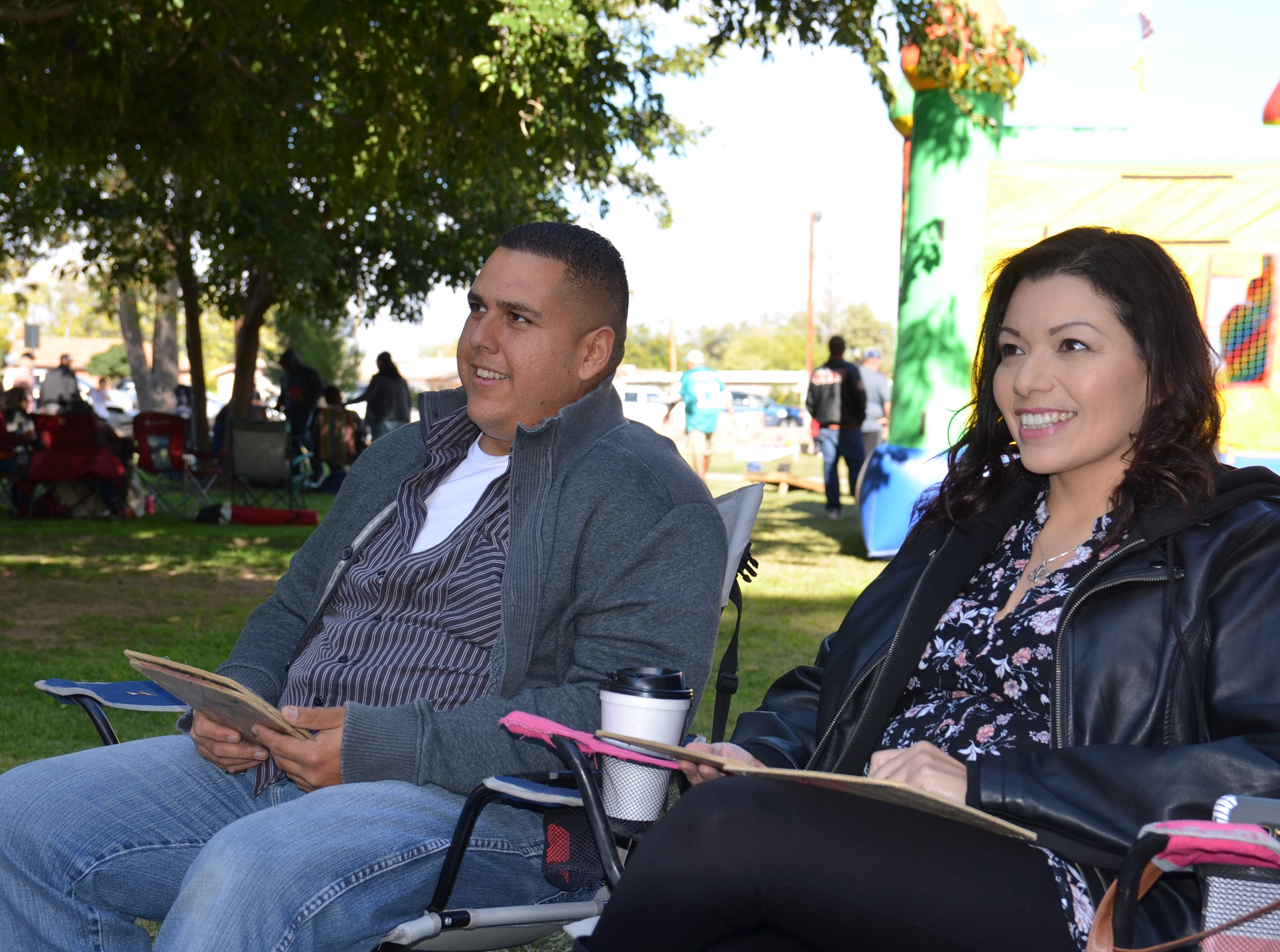 Left to right: Alex Romero Irene Trejo eagerly await for their numbers to be called during the bingo activity at the Klobase Festival at Court County Park on Sunday.