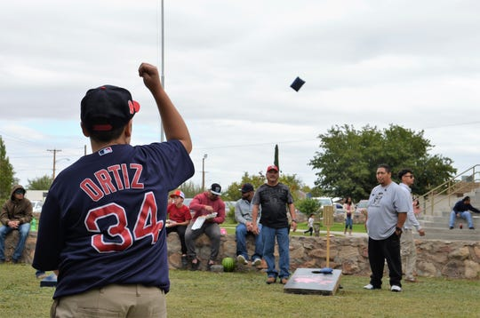 Javier Gallosa, 14, throws a corn bag during the corn hole tournament during the Klobase Festival on Sunday.