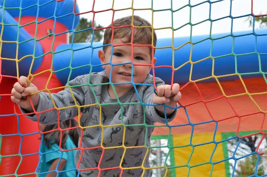 Elias Green, 2, of Phoenix Arizona spent time in the jumping balloon provided at the Klobase Festival. His father is a Deming native and recalls jumping in jumping balloons during prior Klobase Festivals.
