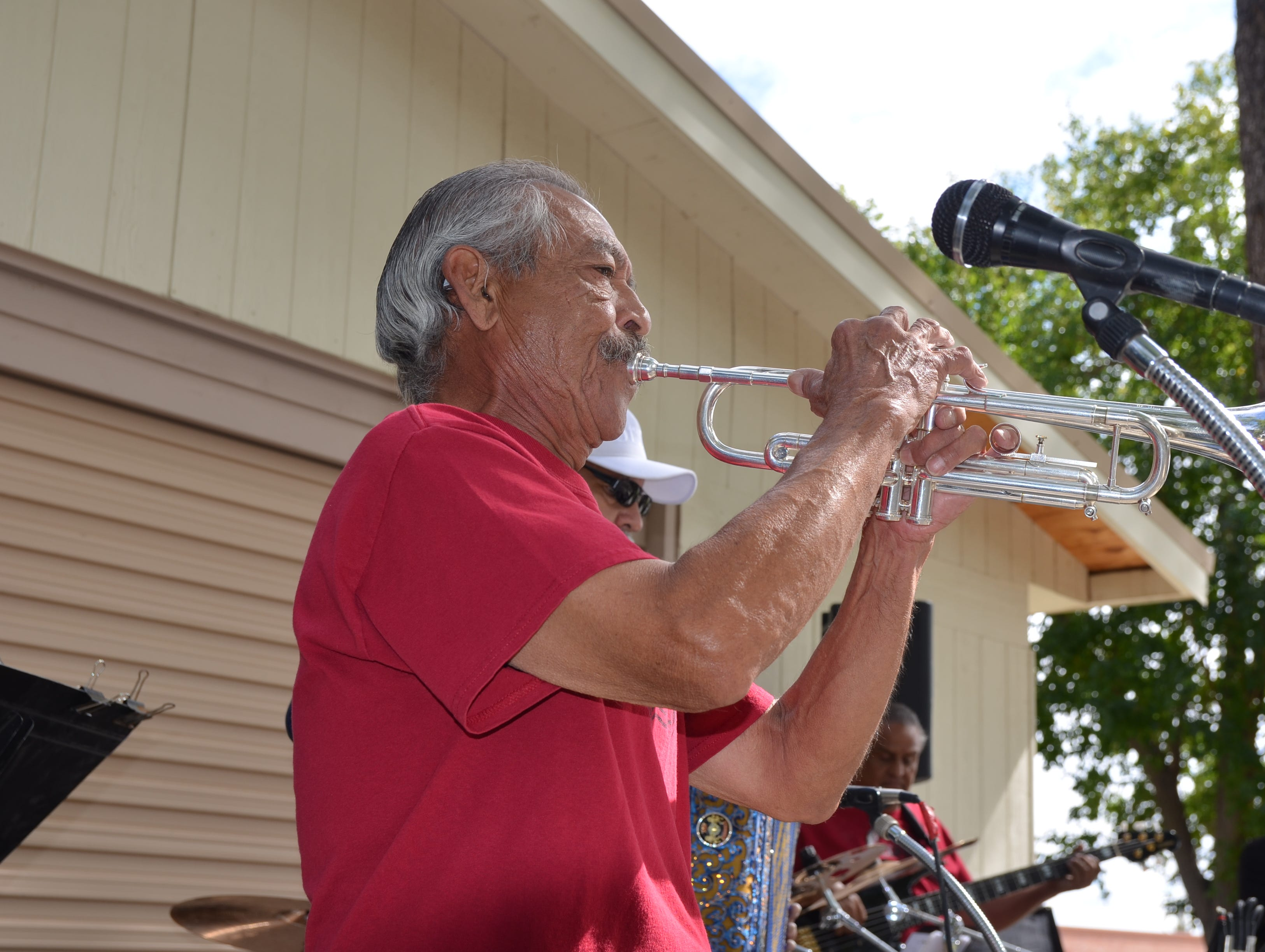 Carlos of the Alegria band played the trumpet during he and his bandmembers play Neon Moon by Brooks and Dunn.