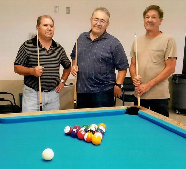 Pictured from left are the September 2018 billiards tournament winners: JR Guevara of Organ, first place; John Arsola of Las Cruces, second place; Ed Chavez of Alamogordo, third place.