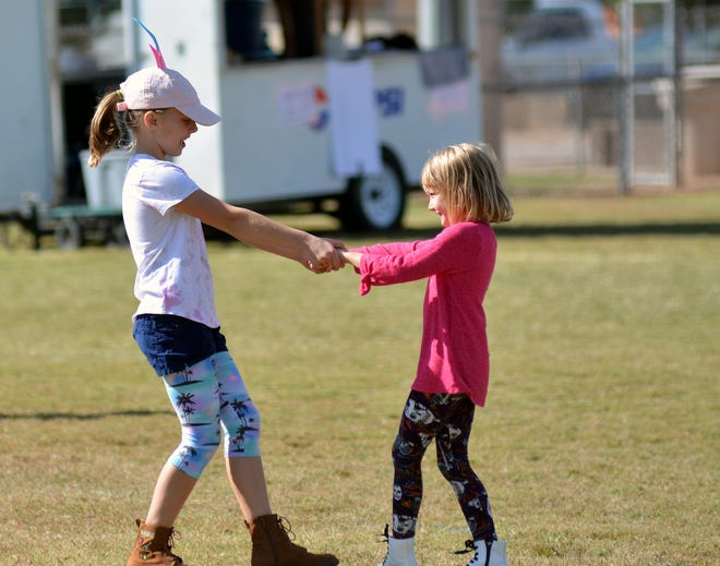 Sisters Grace Winters, left, and Harper Winters, dance to the afternoon's music at the Las Cruces Country Music Festival on Sunday, Oct. 21, 2018.