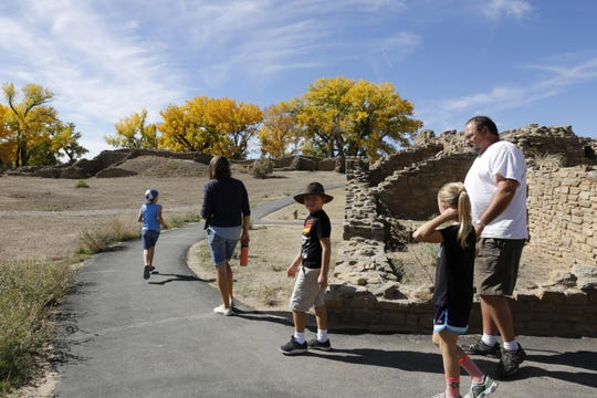 Charlie Bier, Michaela Bier, Oliver Bier, Emma Bier and Carl Bierschied visit Aztec Ruins National Monument Monday in Aztec.