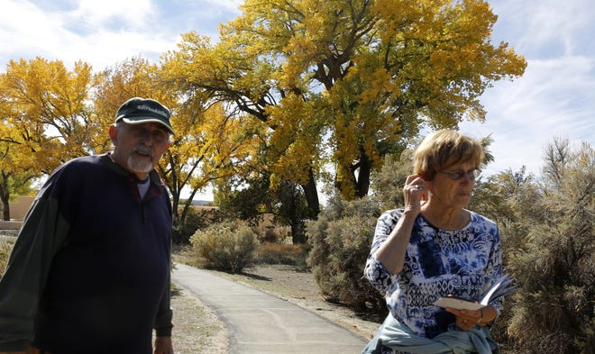 Jack and Arlene Maran of Glenville, New York, explore Aztec Ruins National Monument Monday in Aztec.