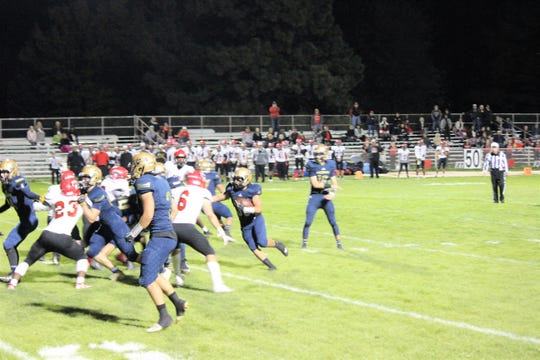 Ruidoso connects the throw from Guardiola hoping to run it in for a touchdown.
