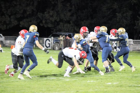 The Warriors fight to hold back the Portales Rams October 19 at home.