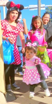 Minnie Mouse and little friend enchanted merchants on the candy march in midtown Ruidoso.