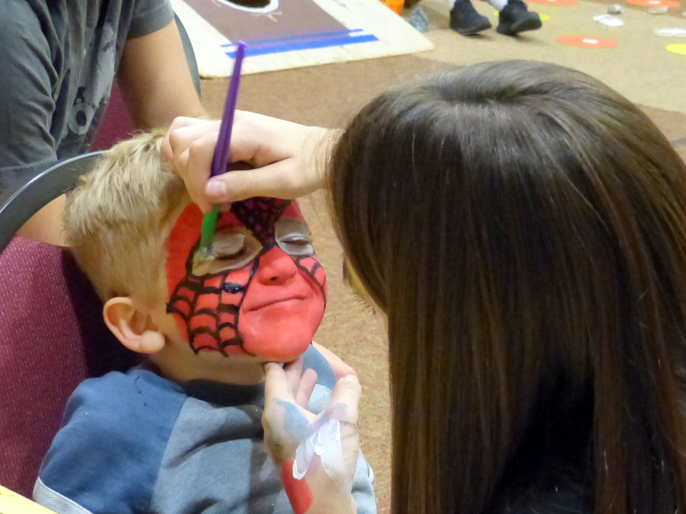 Face painting always is popular.