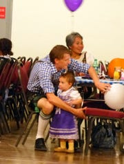 A family dresses the part for Oktoberfest.