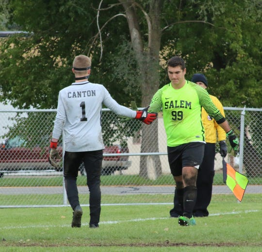 Canton's Ian Nielsen (left) and Salem's Buraq Oral congratulate each other after Sunday's district final.  Both were outstanding throughout the game.