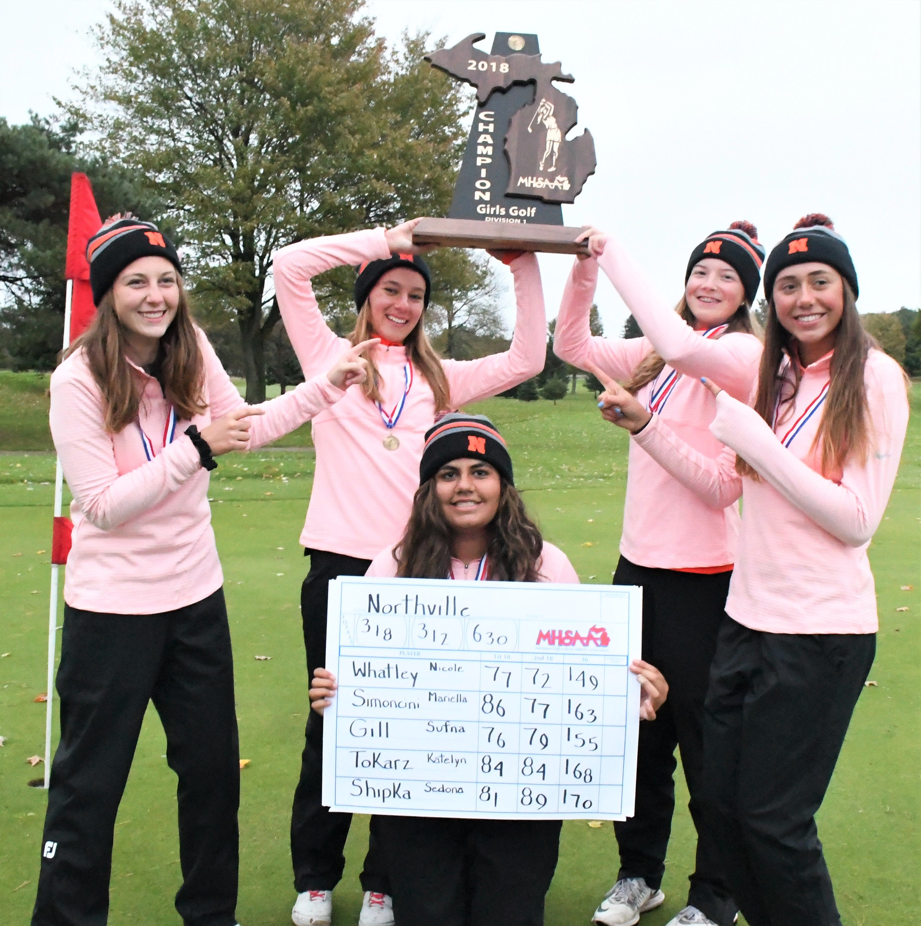 The Northville girls golf team celebrates its first-ever Division 1 state championship on Oct. 20 in Battle Creek.