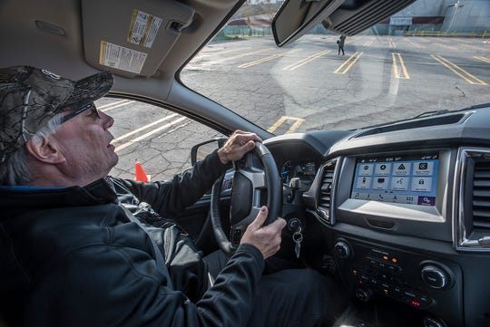 Doug Campbell, an engineer at the plant, gives off-road rides in the new Ranger.