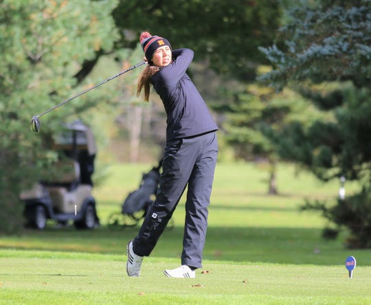 Northville senior captain Mariella Simoncini went out a winner in her final match for the Division 1 champion Mustangs.