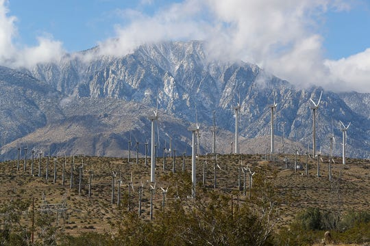Older and newer wind turbines produce energy on a windy day in February 2018. In the background is Mt. San Jacinto.