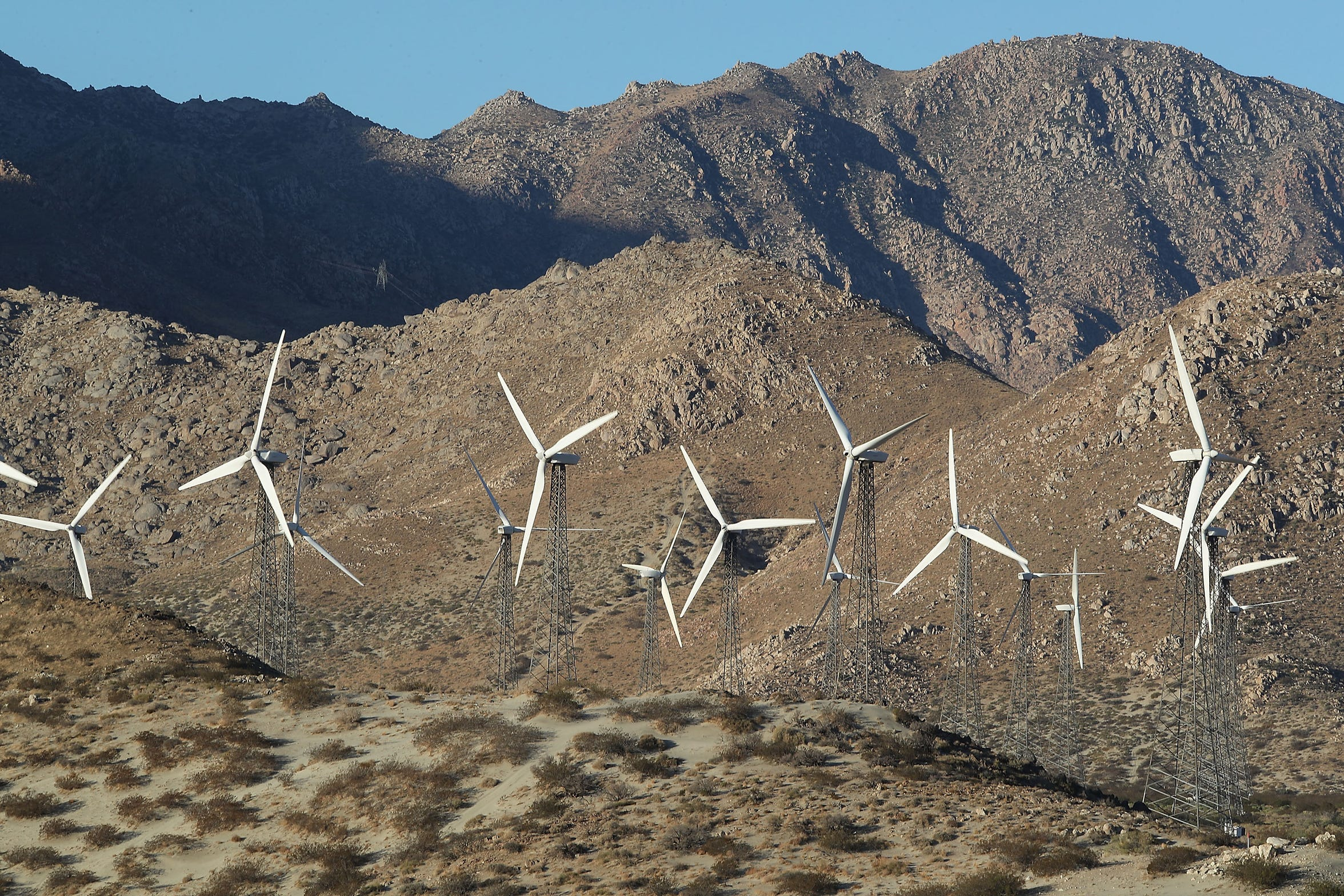 Older wind turbines with steel lattice towers, built in 1985 and owned by Fred Noble's Wintec Energy, spin in the San Gorgonio Pass on Oct. 18, 2018.