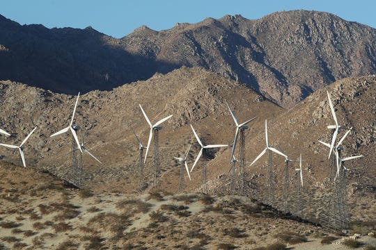 Older wind turbines with steel lattice towers, seen in the San Gorgonio Pass on Oct. 18, 2018.