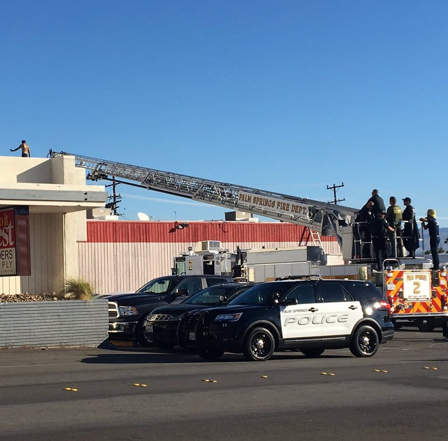 Palm Springs man in custody after climbing atop roofs of businesses, pacing and ranting; road reopened