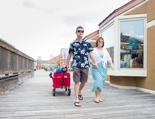 Zach and Shauna Roberson of Olathe, Kansas, walk Monday along the boardwalk at Pensacola Beach.