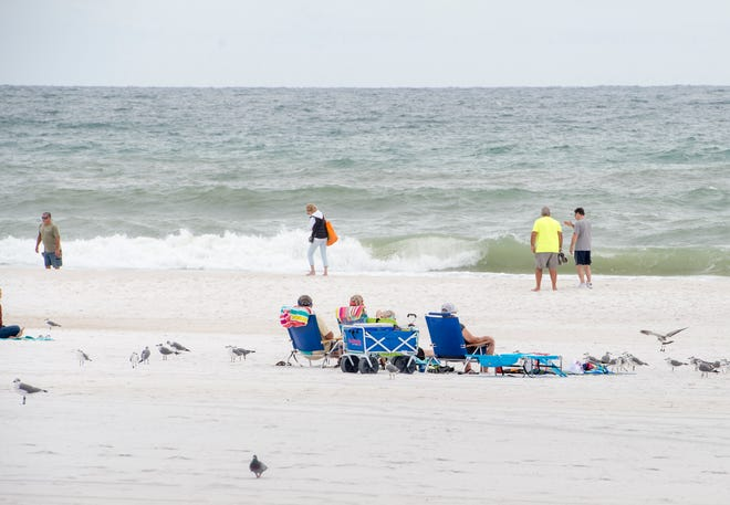 People take advantage of the cooler weather along Pensacola Beach on Monday, October 22, 2018.