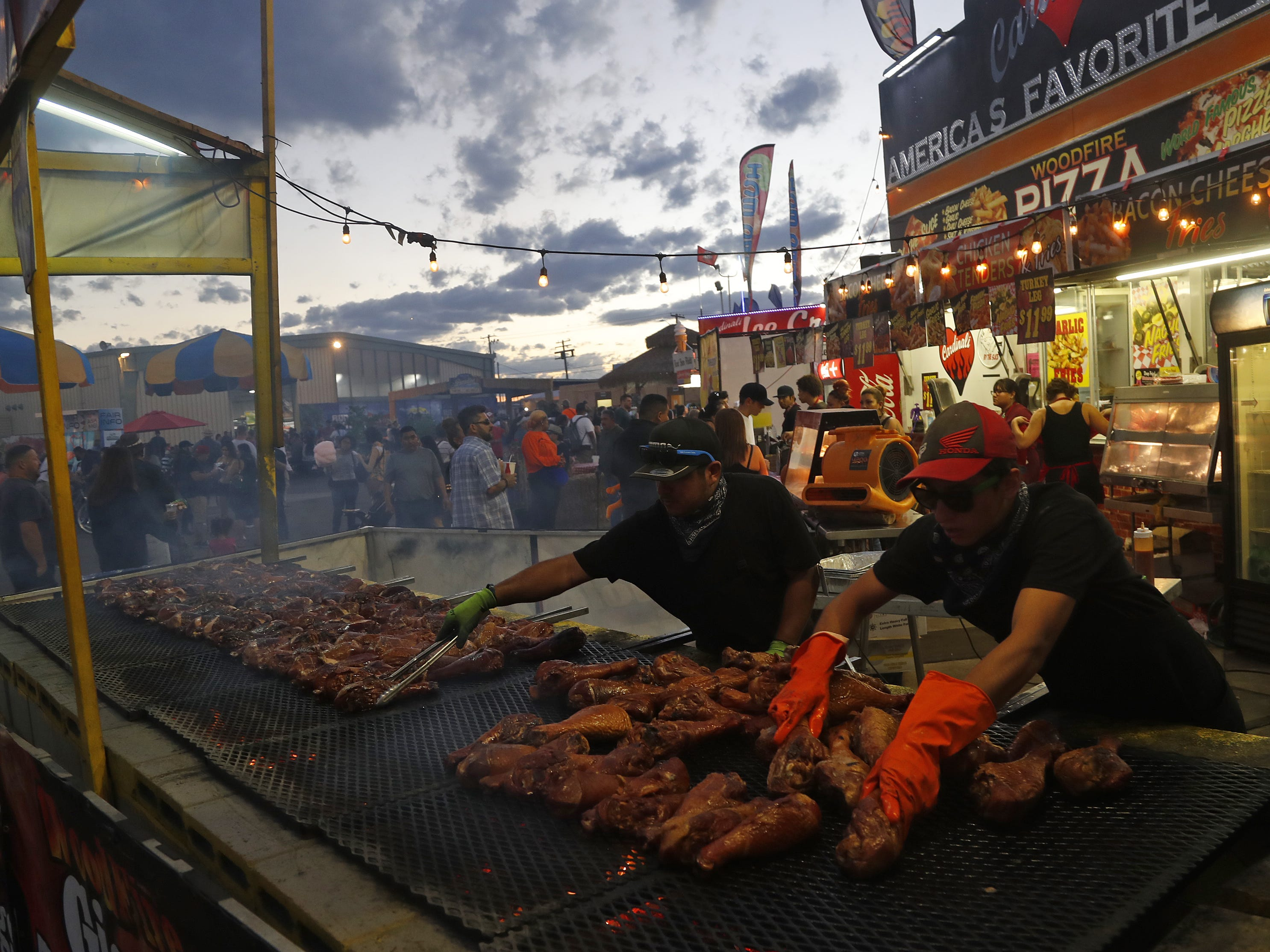 Turkey legs are grilled and spread out at Pigley's at the Arizona State Fair in Phoenix, Ariz. on October 21, 2018.