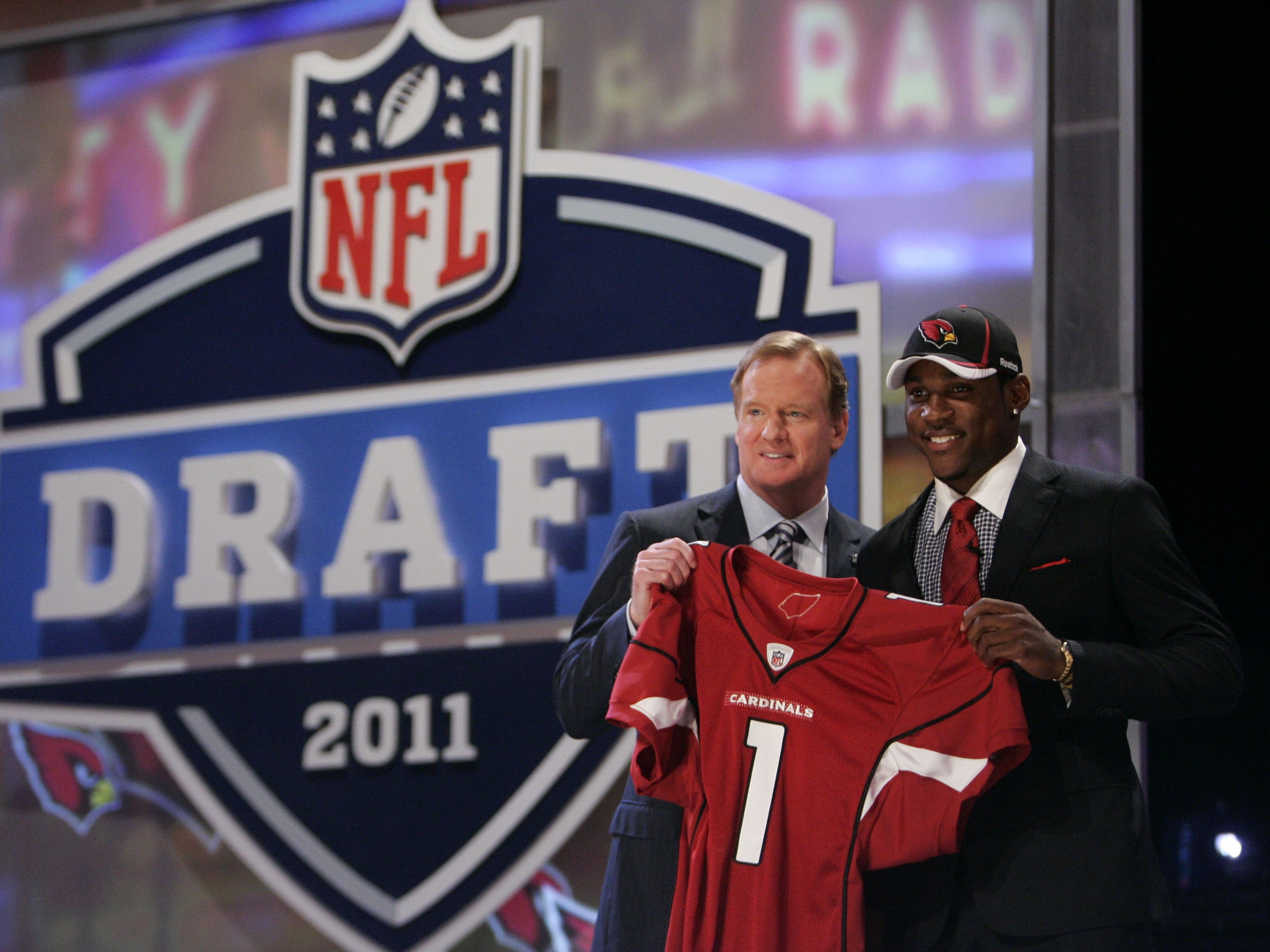 Apr 28, 2011; New York, NY, USA; NFL commissioner Roger Goodell introduces cornerback Patrick Peterson (LSU) as the number five overall pick to the Arizona Cardinals in the 2011 NFL Draft at Radio City Music Hall. Mandatory Credit: Jerry Lai-US PRESSWIRE