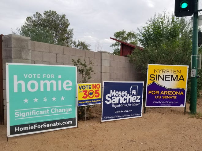 A teal Homie sign advertising a real estate firm and not an election or candidate