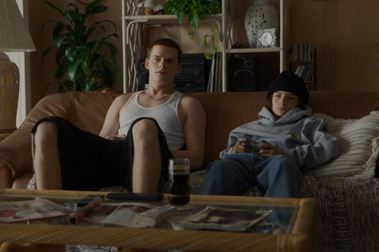 "Brothers Ian (Lucas Hedges, left) and Stevie (Sunny Suljic) play videogames in ""Mid90s."""