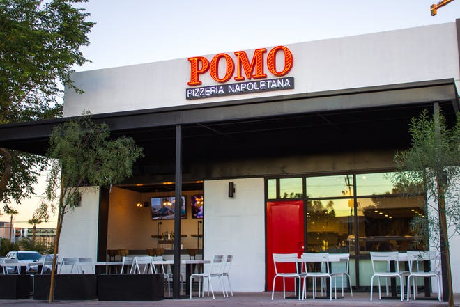 Pomo Pizzeria in downtown Phoenix is debuting a new modern, industrial facade with rolling patio doors.