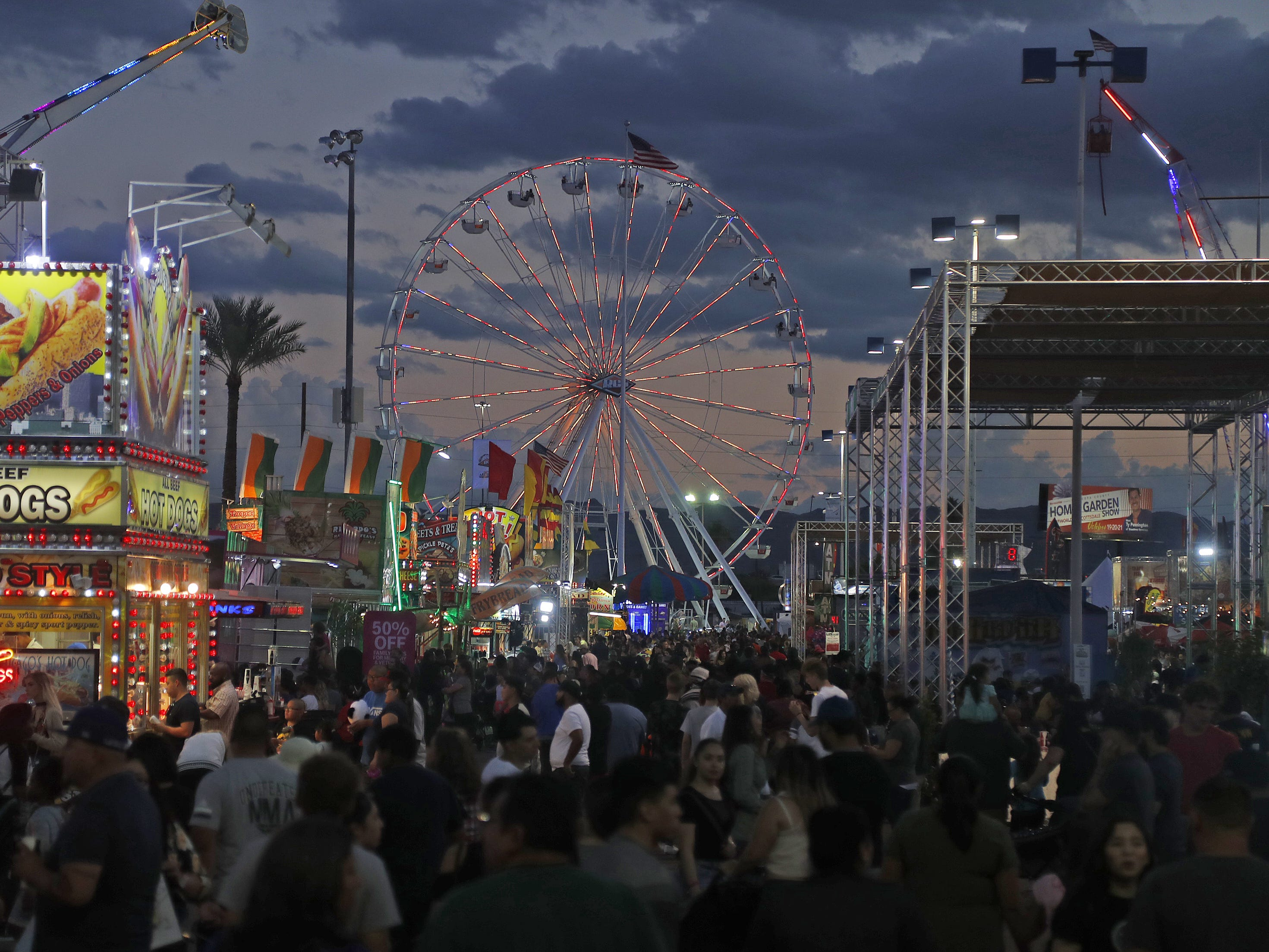 The ferris wheel stands tall over the crowds at the Arizona State Fair in Phoenix, Ariz. on October 21, 2018.