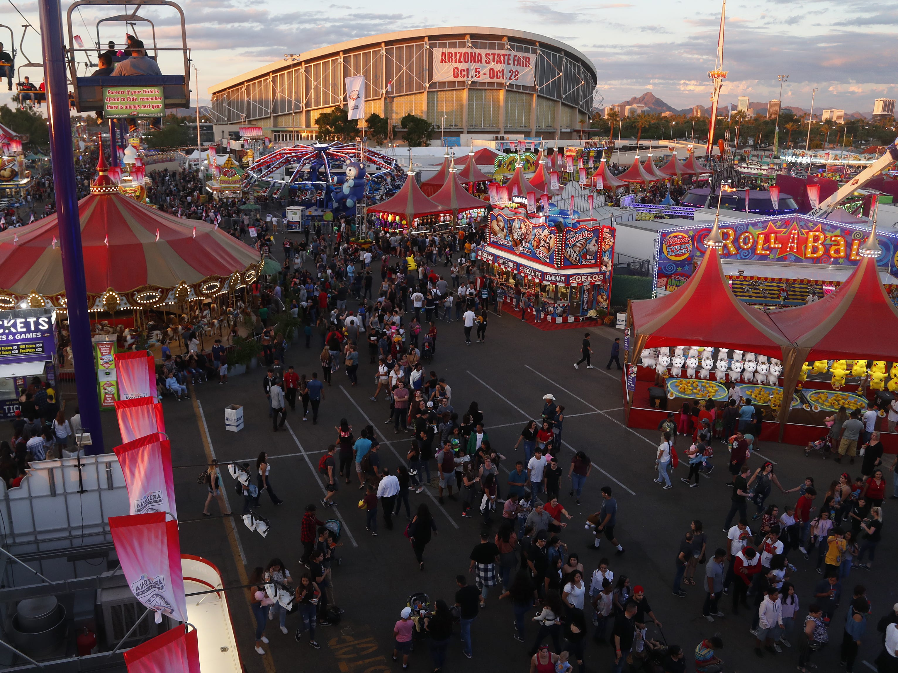 People make their way around at the Arizona State Fair in Phoenix, Ariz. on October 21, 2018.