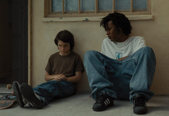 "Stevie (Sunny Suljic, left) has a heart-to-heart with an older and wiser friend named Ray (Na-kel Smith) in ""Mid90s."""