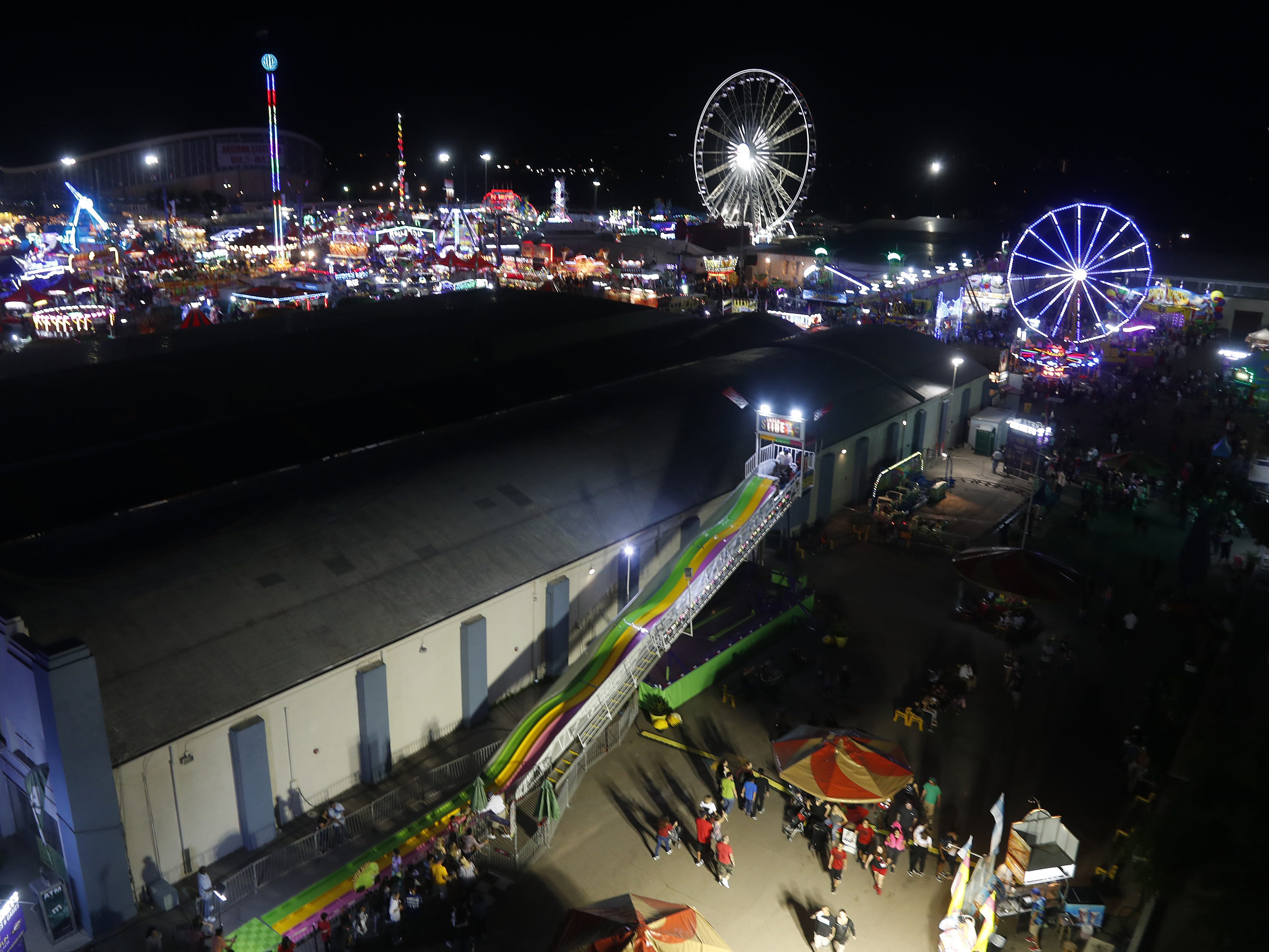Rides light up the sky at the Arizona State Fair in Phoenix, Ariz. on October 21, 2018.