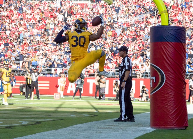 Los Angeles Rams running back Todd Gurley (30) celebrates after scoring a touchdown against the San Francisco 49ers during the third quarter at Levi's Stadium.
