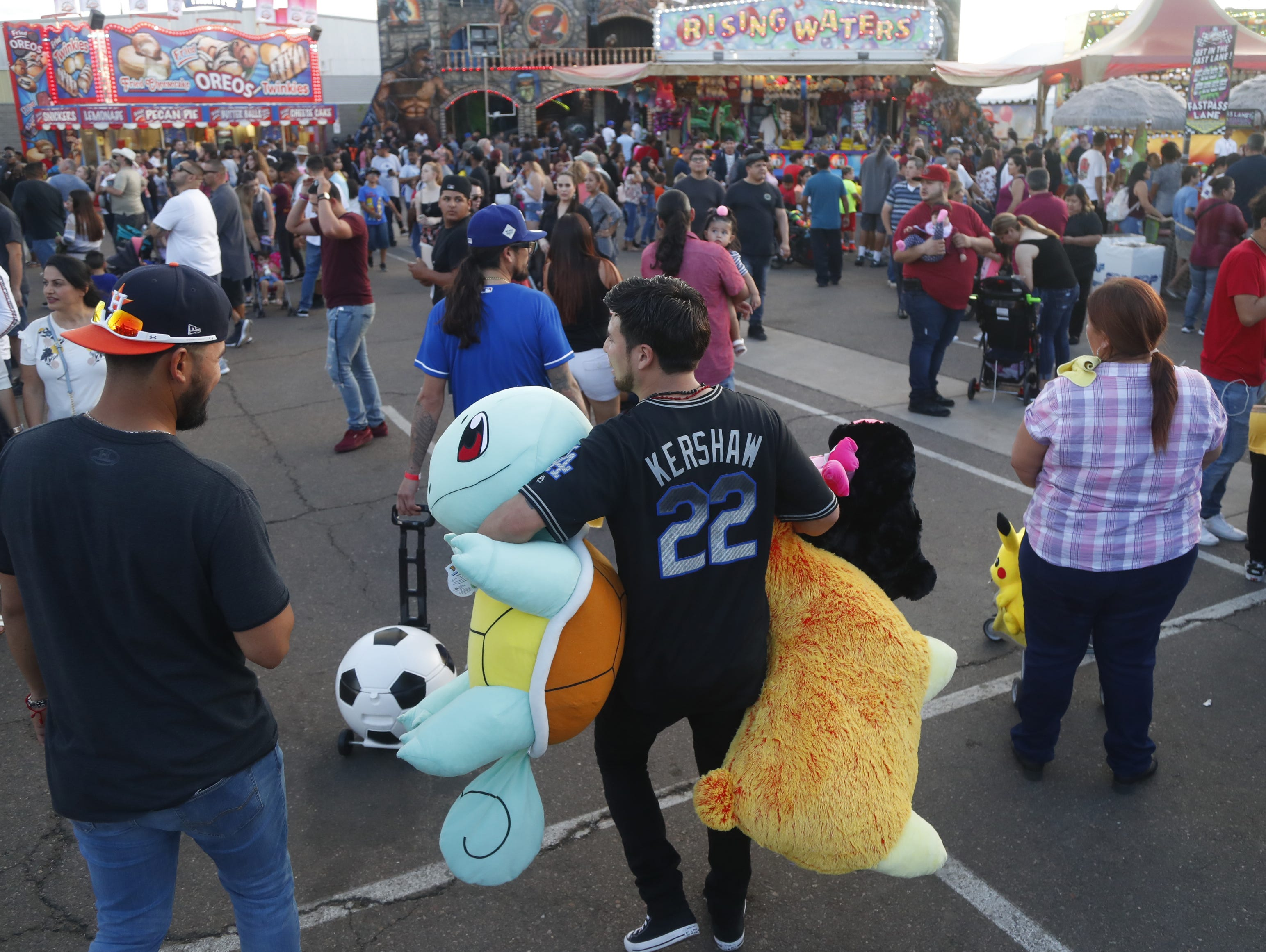 Fair-goers make their rounds in packed crowds at the Arizona State Fair in Phoenix, Ariz. on October 21, 2018.